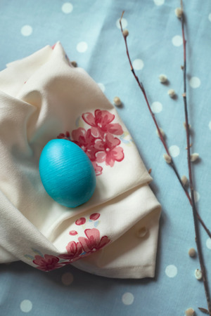 easter flowers: Easter decoration - a wooden eggs on a fabric napkin, with willow branches, shallow focus on egg