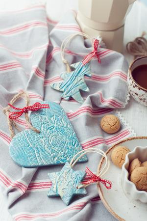 Handmade ceramic Christmas decorations set with italian biscuits amarettini and coffee photo