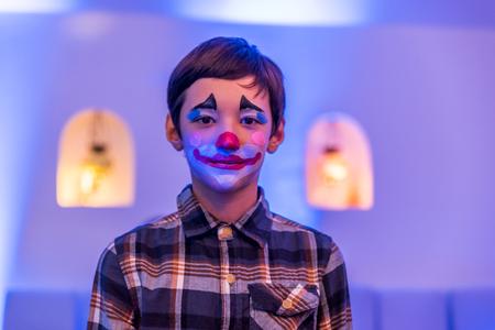 visage: Young boy with aqua makeup on face Stock Photo