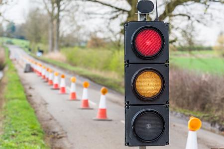 UK Motorway Roadworks Red Yellow Traffic Lights Cones Stock Photo