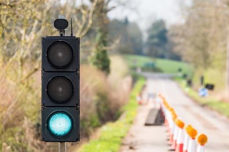 UK Motorway Roadworks Green Traffic Lights Cones Stock Photo