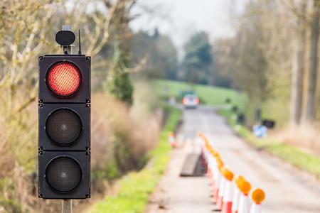 no movement: UK Motorway Roadworks Red Traffic Lights Cones