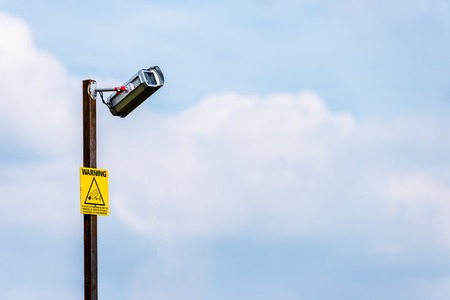 Day View of Broken CCTV camera with yellow notice Stock Photo