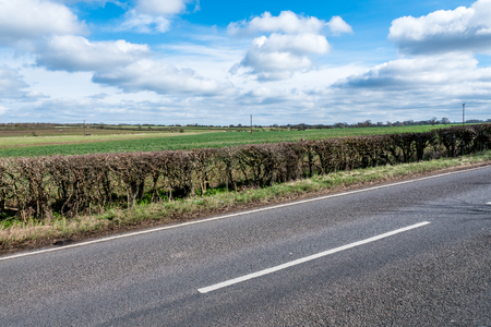 Sunny Day View of Empty UK Country Road Banco de Imagens