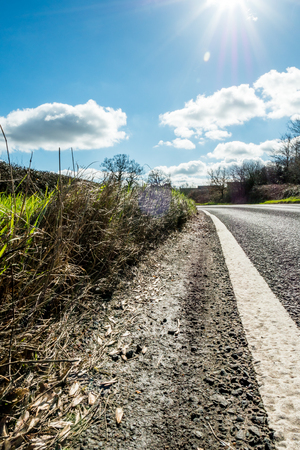 Sunny Day View of Empty UK Country Road Stock Photo