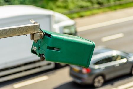 Day view of average speed traffic camera over UK Motorway Stock Photo