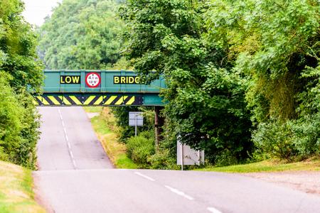 overbridge: Day view of UK motorway highway under railway bridge