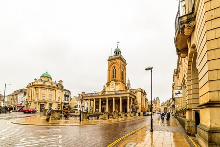 Northampton, UK - Aug 08, 2017: Cloudy rainy day view of All Saints Church in Northampton Town Centre