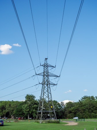 electric grid: Electric wire electric tower on clear sky background
