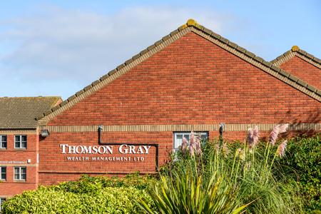 Northampton UK October 3, 2017: Thompson Gray Wealth Management logo sign stand Northampton industrial estate. Editorial