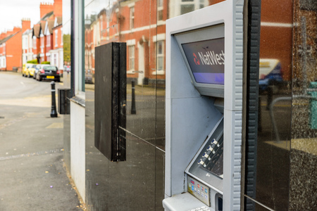 Northampton UK October 3, 2017: Natwest bank ATM closed down with wooden board Northampton.