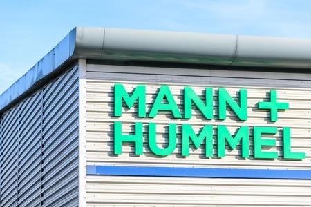 Northampton, UK - Oct 25, 2017: Day view of Mann Plus Hummel logo at Riverside Retail Park