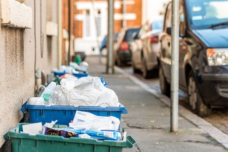 Day view plastice waste refuse bins boxes on British road Stock Photo