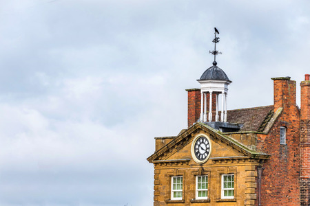 Day view of The Moot Hall building roof in Daventry town centre