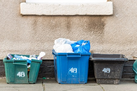 Day view plastice waste refuse bins boxes witn number 48 on British road Stok Fotoğraf