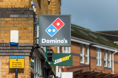 Daventry UK March 13 2018: Day view of Dominos Pizza logo sign in town centre Editorial