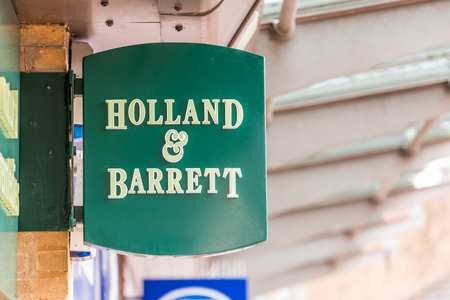 Daventry UK March 13 2018: Holland and Barrett logo sign in Daventry town centre