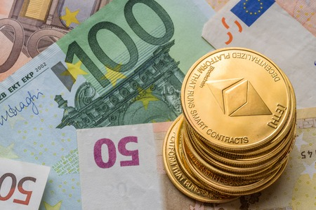 Ethereum coins stacked on Euro notes, future concept financial currency, crypto currency sign Stock Photo