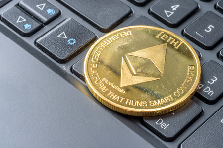 Ethereum coin symbol on laptop, future concept financial currency, crypto currency sign