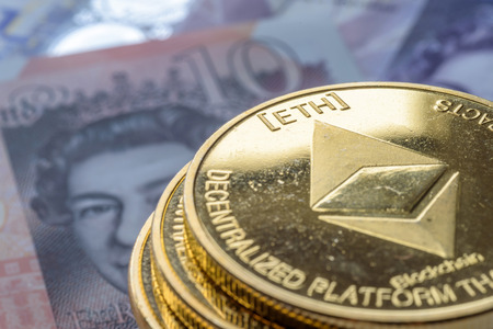 Ethereum coins stacked on new British Pound Sterling note, future concept financial currency, crypto currency sign