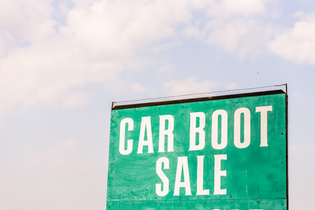 Car boot sale This Sunday sign with sky on bachground Stock Photo