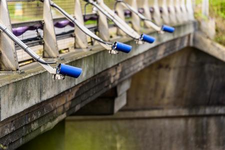 Row of Speed cameras monitoring traffic on UK Motorway 免版税图像