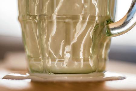 Closeup overhead view of empty fresh kefir probiotik drink on kitchen table