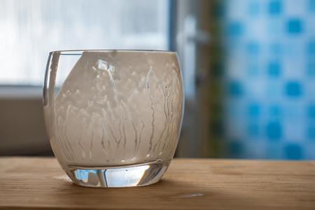 Closeup view of empty glass of fresh kefir probiotik drink on kitchen table Stockfoto