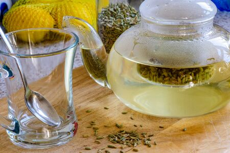fennel seeds inside glass teapot being brewed for healthy drink