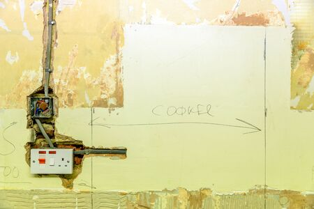 electric socket in a wall during renovation in england uk Banque d'images