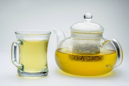 fennel seeds loose inside glass teapot brewed for healthy drink on white background