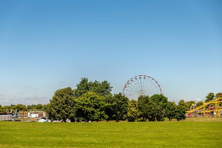 amusement park rides landscape with a very blue sky as background in england uk