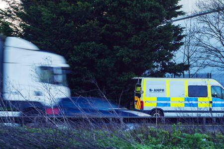 anpr camera van on uk motorway with traffic passing in foreground in england uk