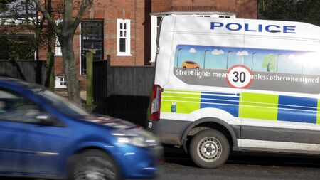 anpr camera van on british town road with traffic passing in england uk
