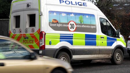 anpr camera van on british town road with traffic passing in england uk.