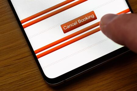 cancel booking text button on smart phone screen