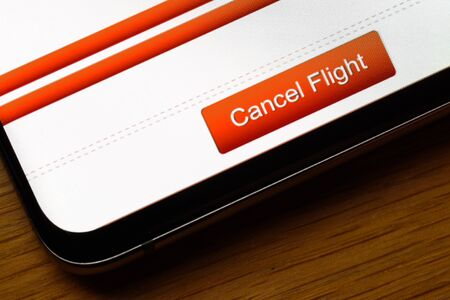cancel flight text button on smart phone screen