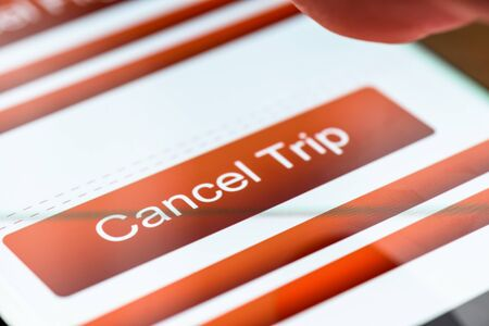 cancel trip text button on smart phone screen 写真素材