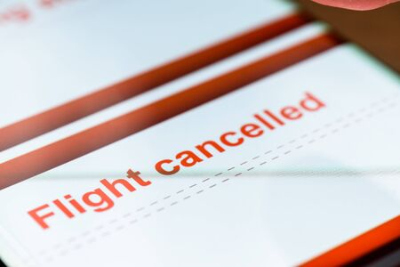 flight cancelled text on smart phone screen
