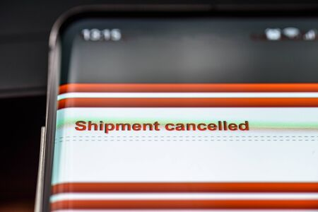 shipment cancelled text on smart phone screen. 写真素材