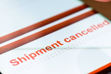 shipment cancelled text on smart phone screen