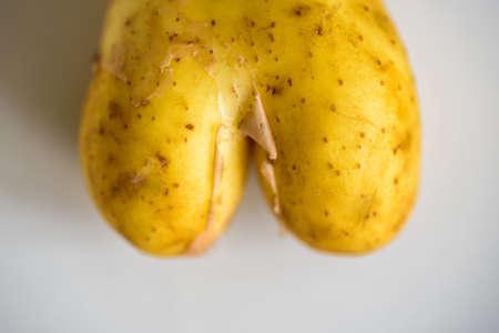 fun heart shape potato on bright background
