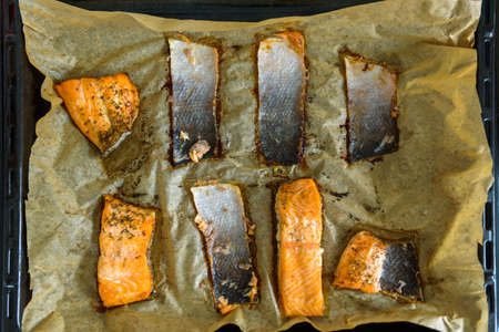 leftovers salmon skin slices on baking paper tray