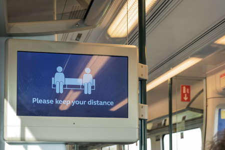 please keep your distance message on digital display on train during covid-19 lockdown in england uk