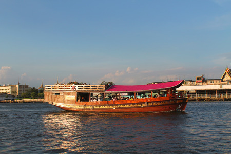 the chao phraya river: Colorful powerboat with people on the Chao Phraya River in Bangkok, Thailand