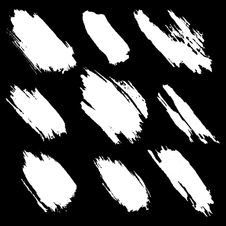 Vector set of white inc splash, blots, smudge and brush strokes, isolated on the black background. Grunge elements for design. Vettoriali