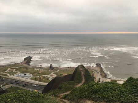 The capital of Peru Lima, a view of the beautiful, majestic Pacific Ocean from a cliff during sunset.