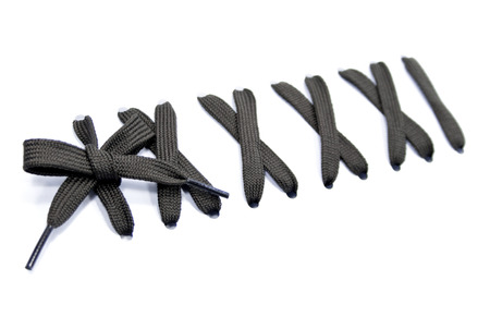 cross ties: dark lace with a bow on a white background Stock Photo