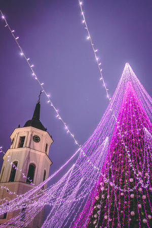 Night view of decorated and illuminated Christmas Tree on the Cathedral Square, Vilnius, Lithuania.