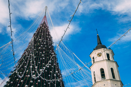 Day view of decorated and illuminated Christmas Tree on the Cathedral Square, Vilnius, Lithuania.